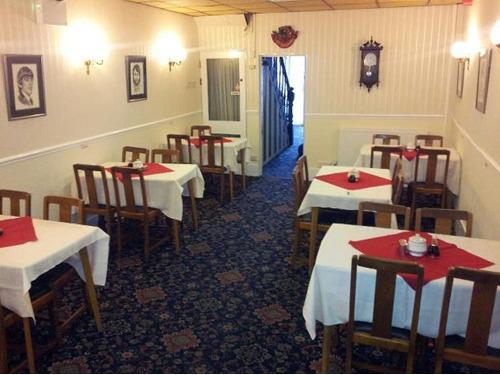 dining room comfortably seats upto 28 guests