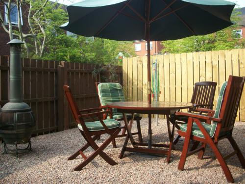 Patio with garden furniture and barbeque
