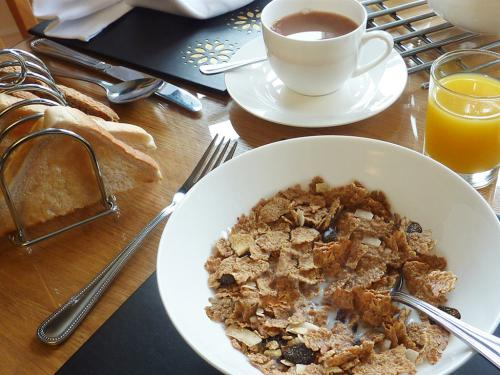 A selection of cereals, toast and jams