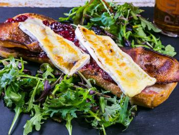 """Our own """"shoe"""" of bread piled high with Local Dorset Bacon Cranberry and Melty Brie"""