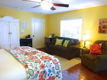 Cypress Room with double size sofa sleeper & flat screen TV in cabinet