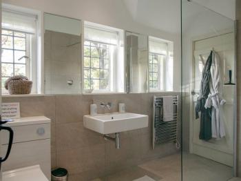 The  sleek modern shower room with underfloor heating and heated towel rail.