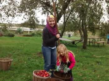 Picking apples on a crisp fall afternoon.