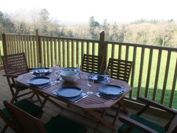 Outside dining area on raised decking with stunning countryside views