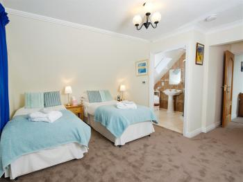 Rock room made up with twin beds, also available as a super king double.