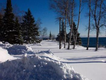 A winter wonderland on the grounds at Thomsonite Beach Inn with Lake Superior in the backdrop.