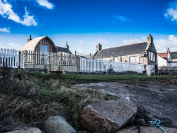 """Pew with a View"" and ""Door to the Shore"", spectacular seafront cottages with secure fence"