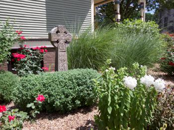 Irish Celtic Cross in side garden