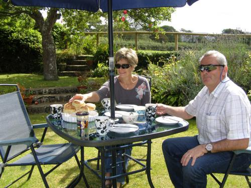 Our guests enjoying a scrumptious cream tea on the lawn