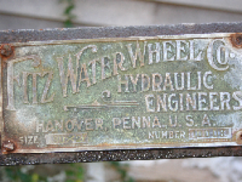 The historic early 1900s Fitz Water Wheel is propelled by the running water of the creek.