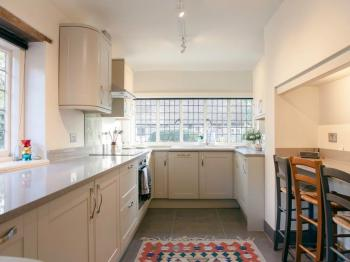 Kitchen: The brand-new fully-equipped kitchen is open-plan with the living space. It has all white goods, including dishwasher and washing machine.
