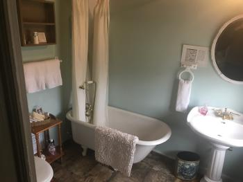 The Willow Room Bathroom and Antique Claw Foot tub