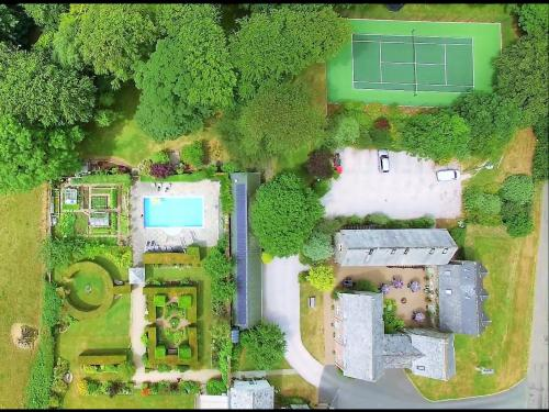 Overview of Tennis Court, Courtyard Area and Heated Pool