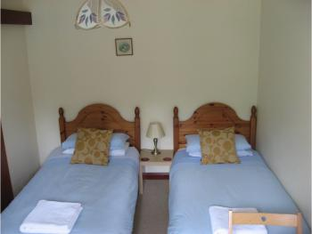Bedrooms for Room 1, 2 and 3 either have a twin bed or double bed
