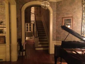 The old stair hall is especially beautiful at night.