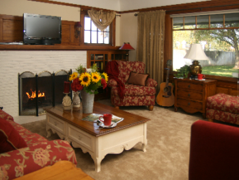 Vintner's cozy living room with a fireplace, television and DVD.