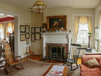 Sitting area with fireplace and antique furnishings