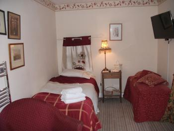 The Garden Room offering twin bedded accommodation with newly fitted wallmounted TV and heated towel rail