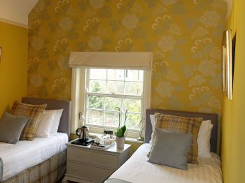 A beautifully decorated, quiet, twin room with ensuite bathroom.