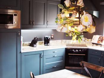 Kitchen with granite work top & built in appliances.