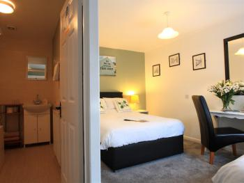 Room No 3.  1 double bed and 1 single bed with bath.