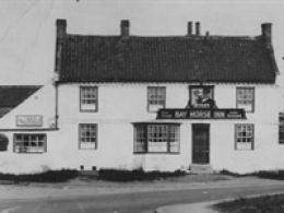 The Bay Horse dates back as early as 1771 and was one of three drinking establishments in the village. The pub is situated on the old York Road (A59).
