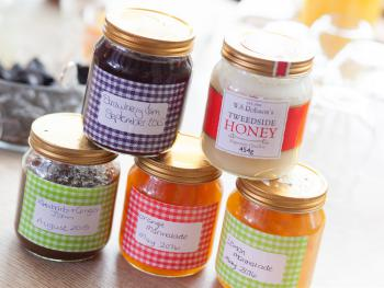A selection of homemade jams and preserves along with local honey