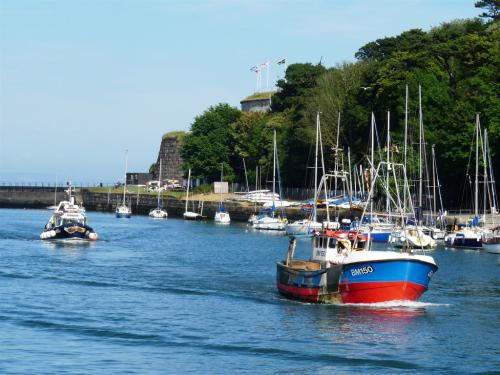 You can spend all day just watching fishing craft navigating the picturesque and historic Harbour