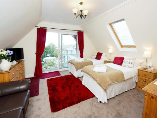 The Polzeath Room with twin beds, plenty of room and balcony overlooking the town.