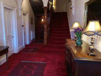 The impressive entrance lobby and staircase at Lochinver Guest House
