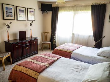 Bedroom 4 Twin Beds or King Size Double or Family Room to sleep 3 with additional bed - Travel Cot also available