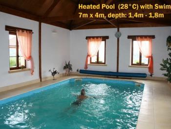 Heated pool with swim jet