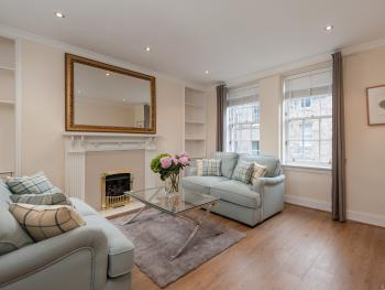 Canongate Apartment - living room overlooks Royal Mile with 2 sofa bed