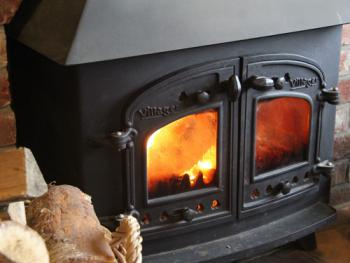 Wood burning stove in The Smithy