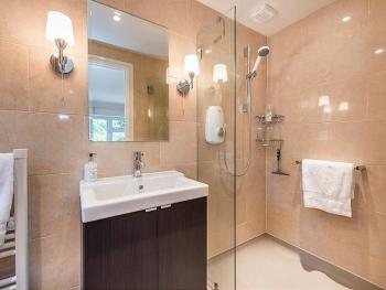 Super King room ensuite with heated floor and towel rail.
