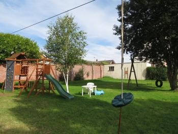 Kids play area, zip wire, climbing wall, BBQ on decking area & picnic benches. Great for kids and dogs