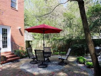 Guest House - Private Patio with a table, chairs and a charcoal grill