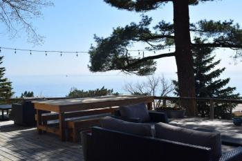 Front deck sitting area with view of Lake Michigan