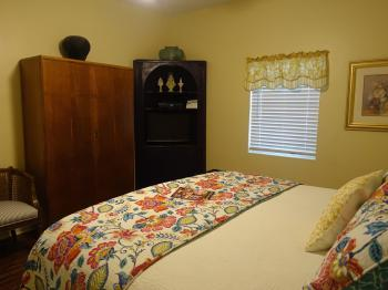 Texas Cottage Bedroom #1 with flat screen TV in cabinet