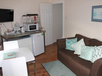 The Magnolia Suite - Your own sitting room with TV, wifi, tea and coffee, microwave, fridge freezer