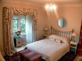 The Gothic Room is elegantly furnished with oriental carpets, artworks, digital TV and wired broadband access.
