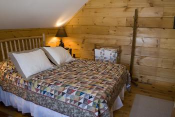 The Adirondack Room with a Queen Sized Bed and a twin. This room sleeps 3.