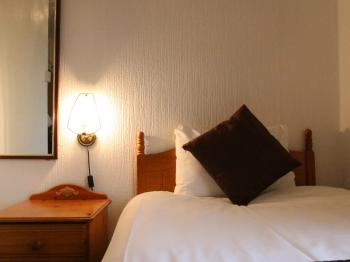 Room 5- Single Bed and bedside cabinet