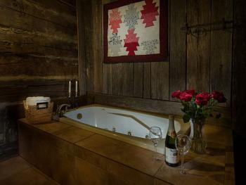 Relax in The Cabin's jetted tub while enjoying the historic Appalachian decor.