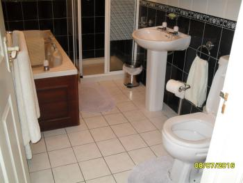 1 bathroom with a bath and separate shower