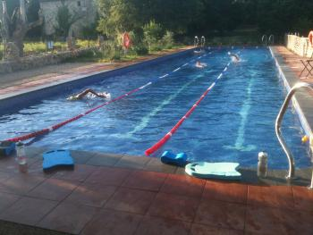 Olympic triathletes training in the onsite pool