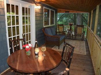 Waterfall Cottage screened porch overlooking creek & falls