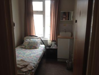 Room 4. small single room on first floor with use of shared shower one floor up.