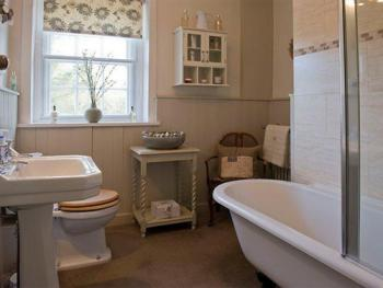 Roll Top bath with shower over in the Coastal Cottage