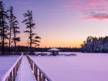 View of the Teahouse and footbridge with a winter sunset